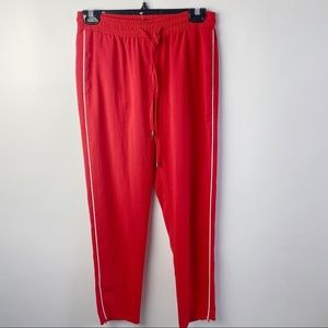 Topshop red joggers with zipper cuffs